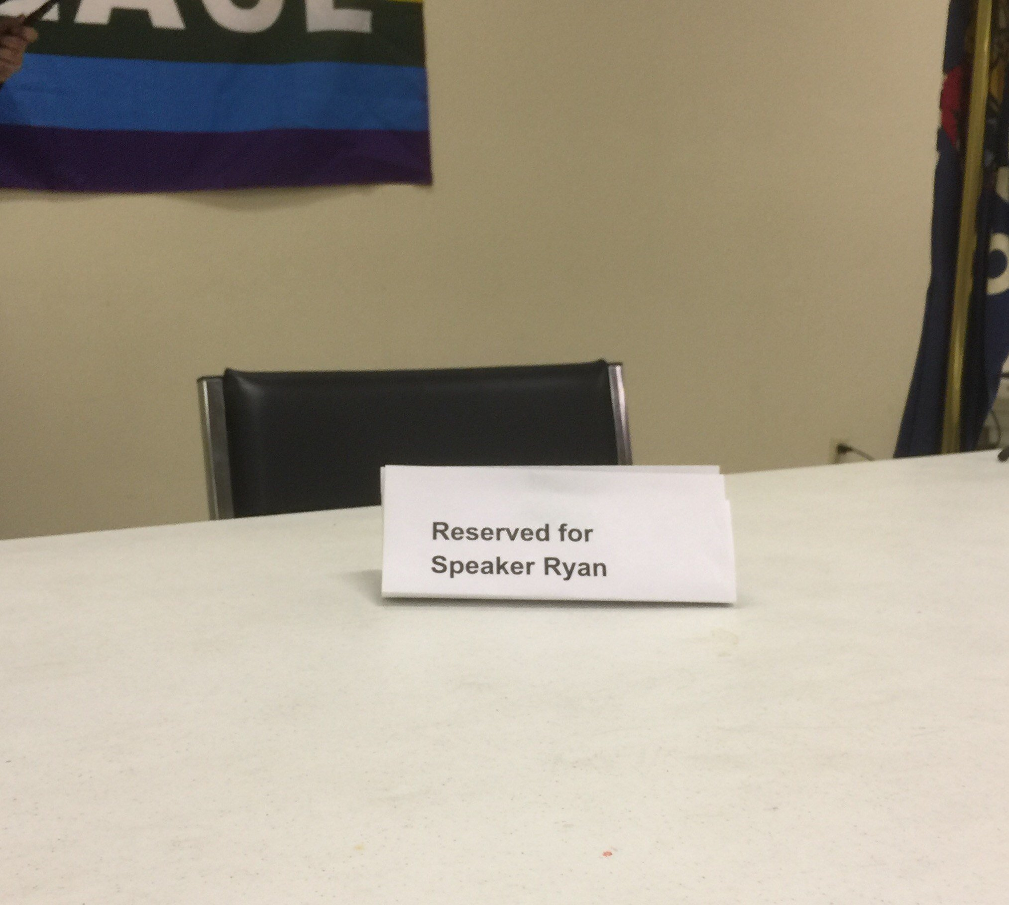 Chair reserved for House Speaker Paul Ryan at Janesville town hall meeting