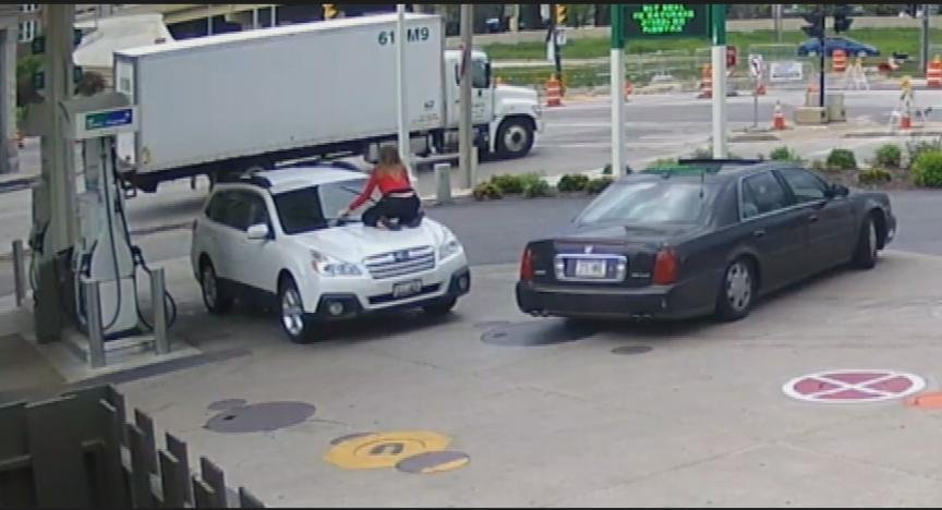 Terrifying video shows woman trying to stop auto theft