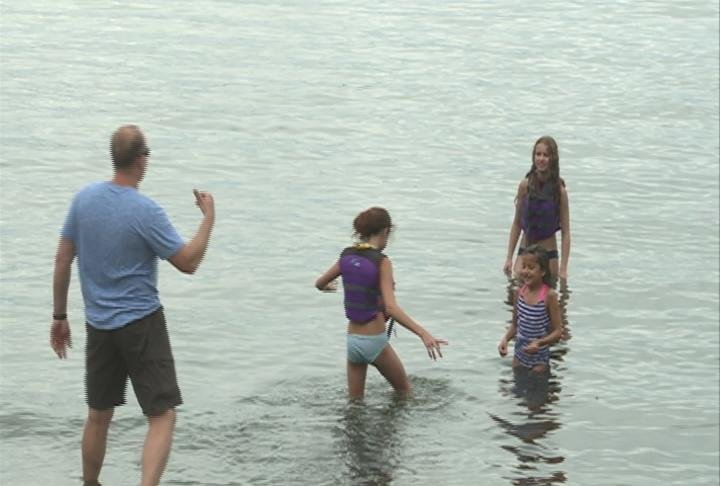 Pierre Kory and his family playing in the water at Marshall Beach Saturday.