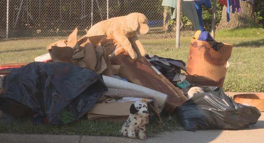 Items left on the curbside in Burlington as residents begin cleanup effort after days of flooding