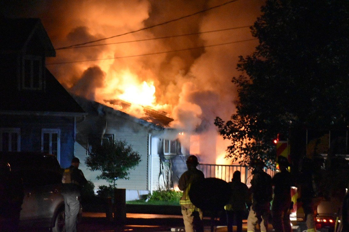 Standoff ends in house fire; suspect arrested