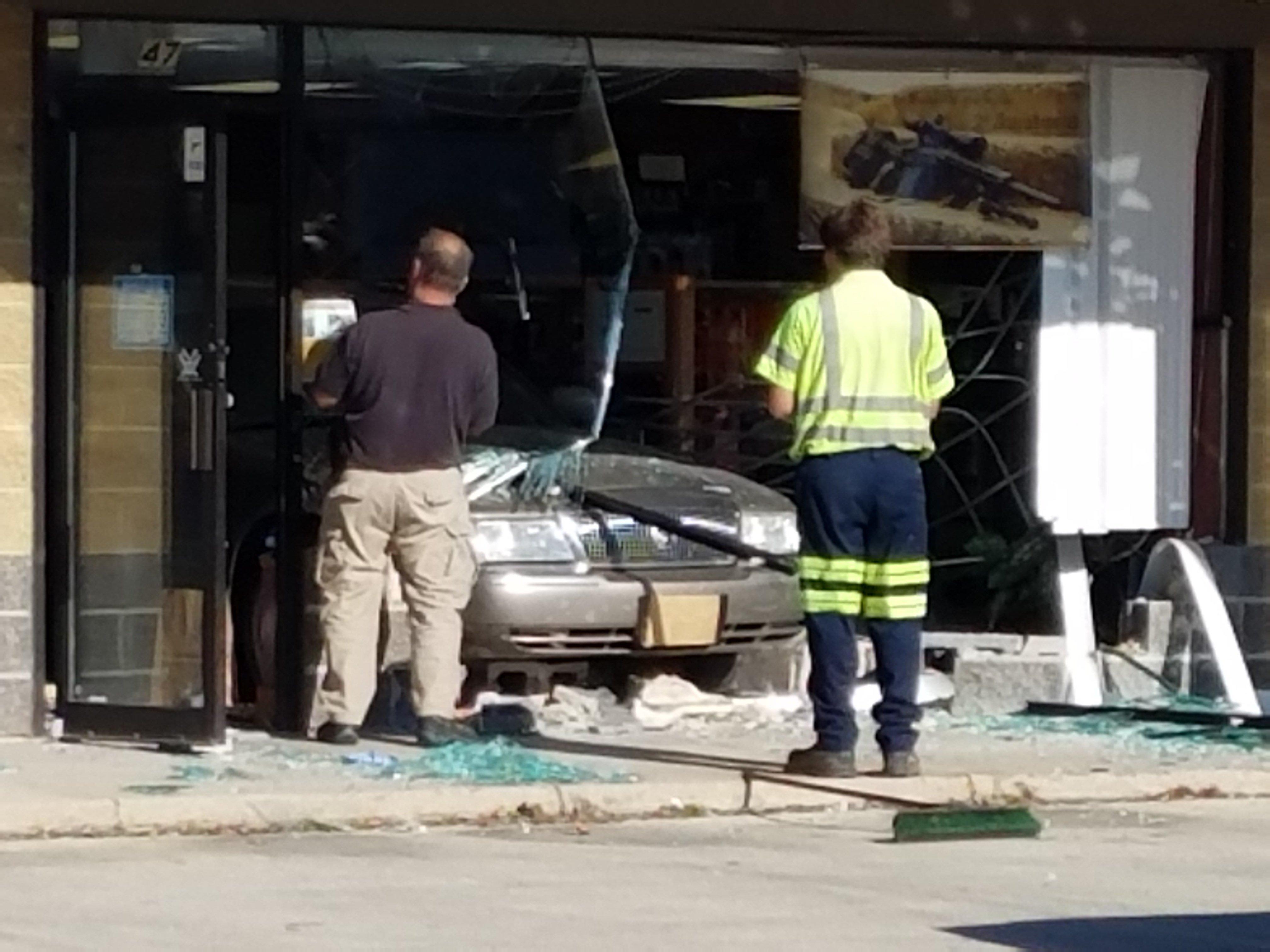 Police collect evidence after burglars crash into Cross Plains gun shop. Tony Galli/WKOW