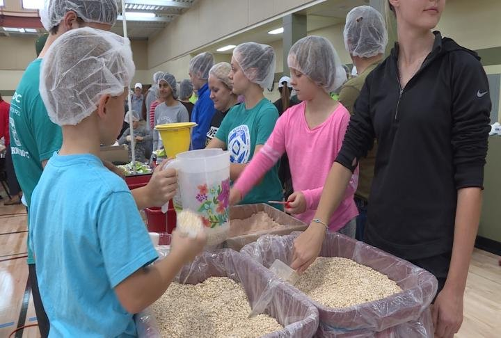 Volunteers help create bags of oatmeal