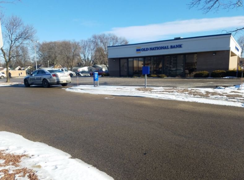 Police Responding To Report Of Bank Robbery On Cottage