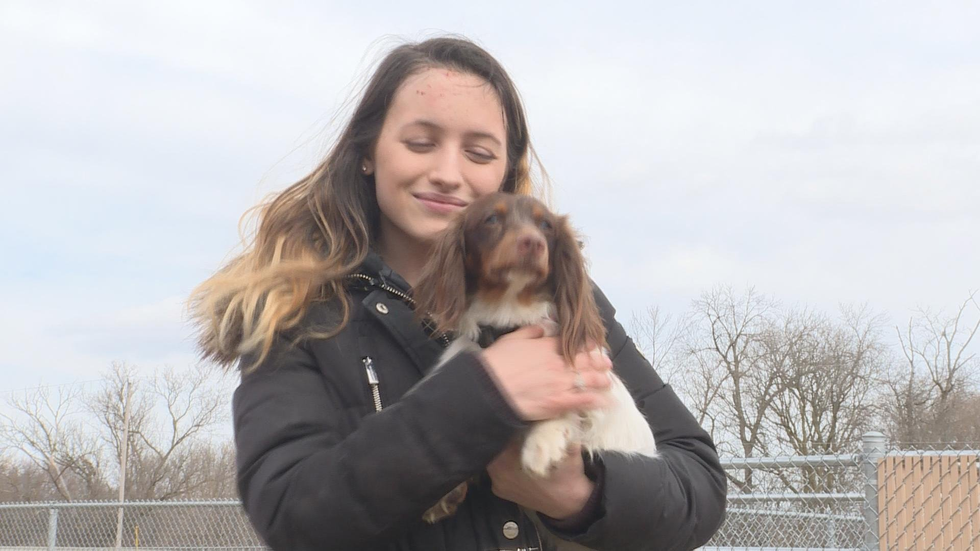 Shelbie Tripp after being reunited with her missing dog Rusty.