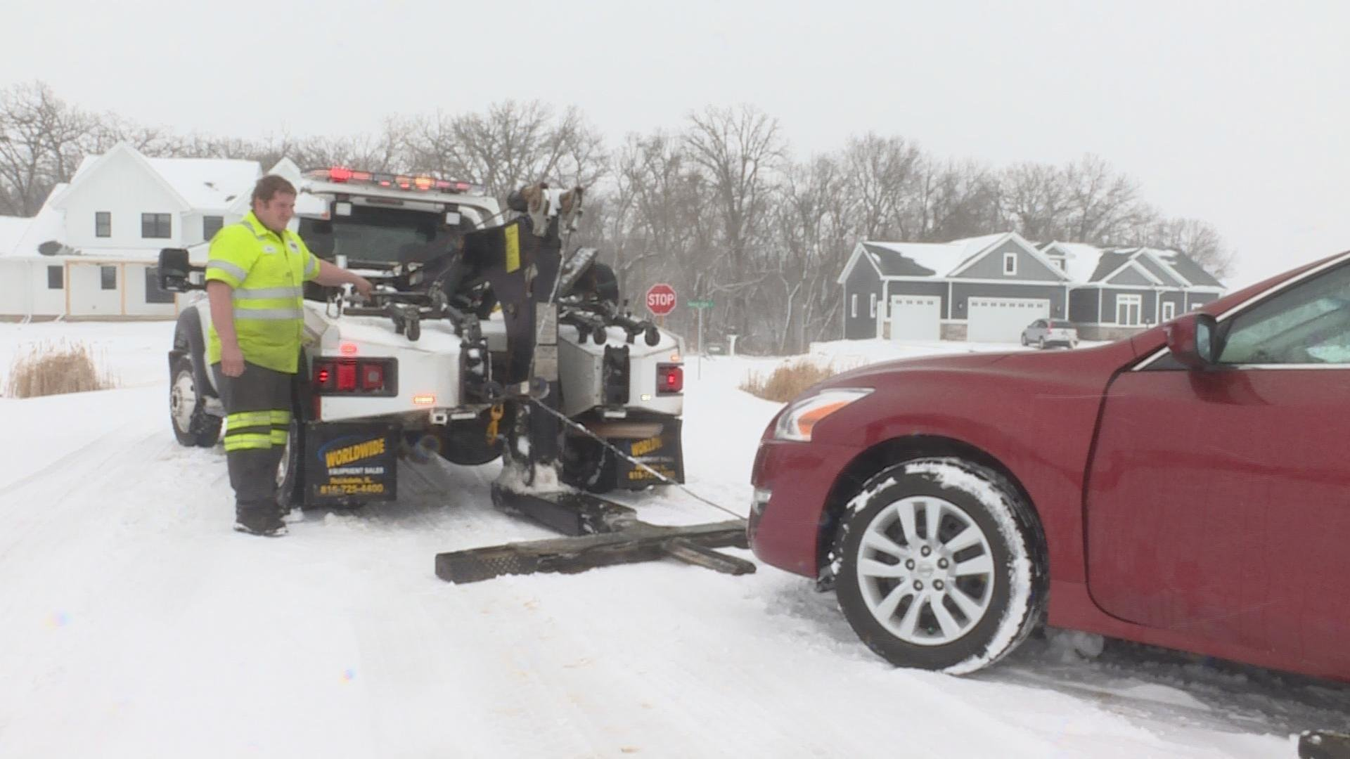 Mark Mecum, with Badger State Towing and Service, pulls a car from a ditch Sunday afternoon.