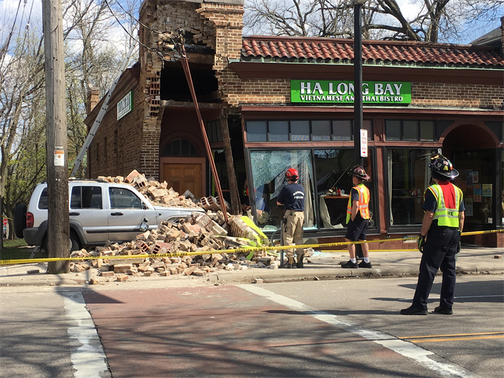 A car lies under a pile of bricks May 4, 2018 after crashing into the Ha Long Bay restaurant on Williamson Street in Madison. Bryan Konicek/WKOW photo.