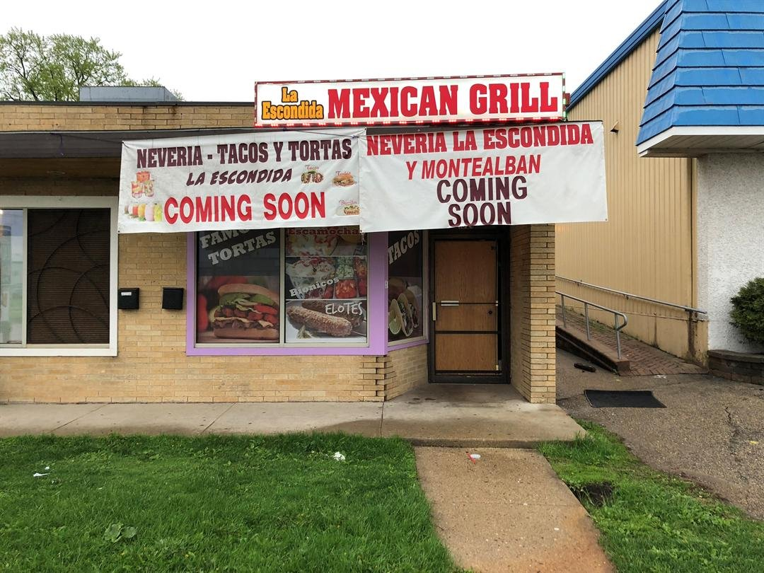 The front door of La Escondida Mexican Grill is boarded up after vandals broke in early Thursday morning.