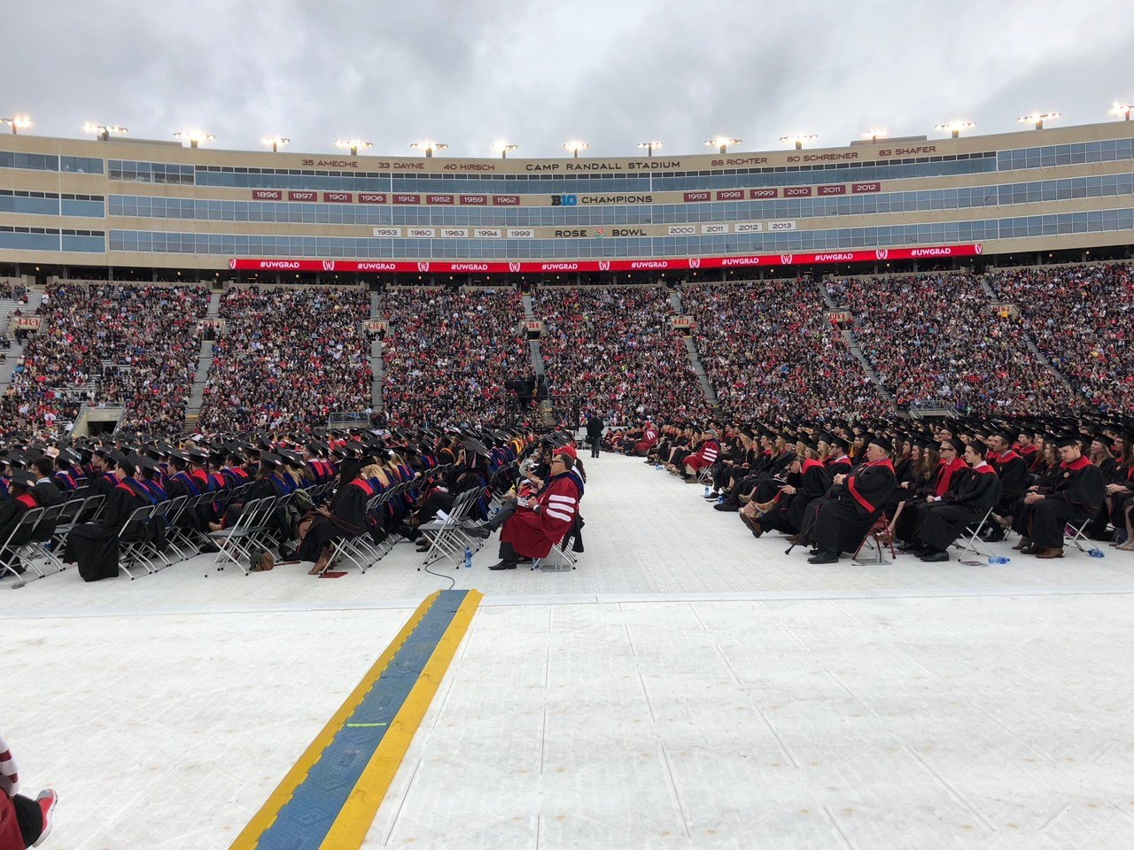 UW graduates seated during the 2018 spring commencement ceremony at Camp Randall.