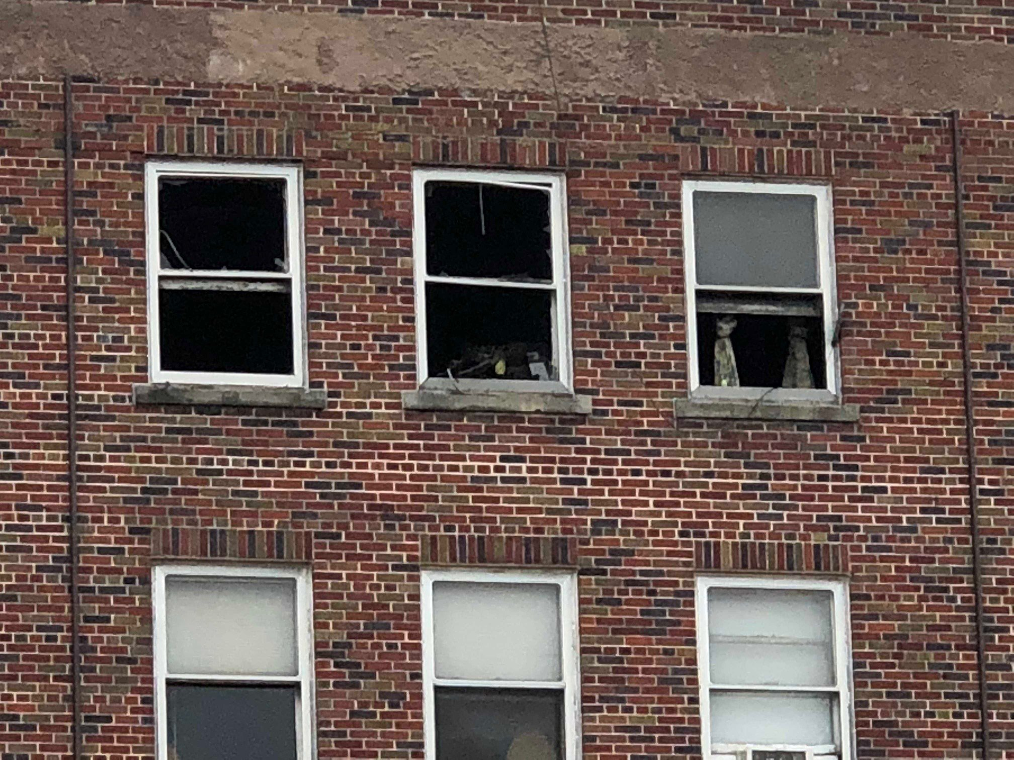 Fire-damaged windows of the Ram Hotel Apartments in Portage.