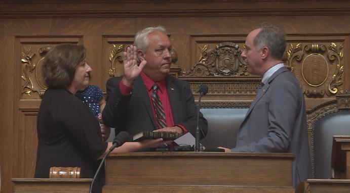 Representative Jon Plumer (R-Lodi) is sworn in by Speaker Robin Vos (R-Rochester)