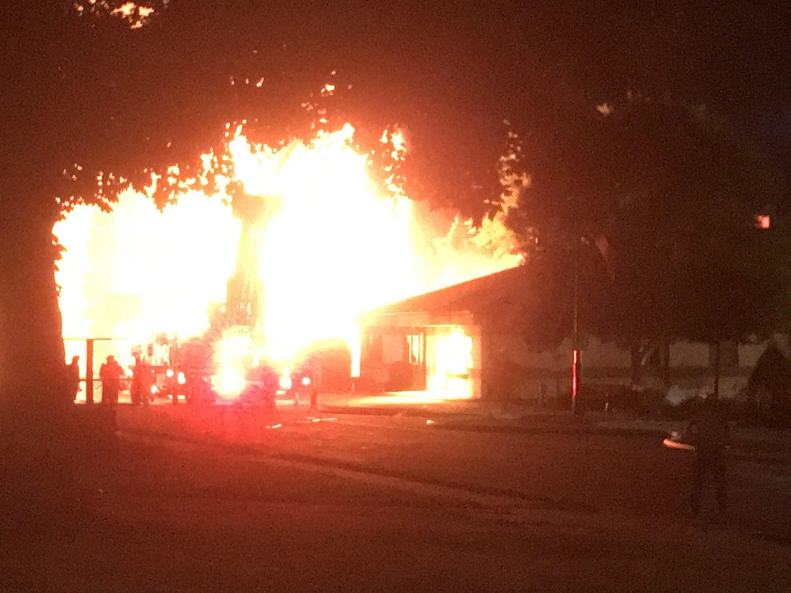 Joseph Powelka house on W. Main St in Sun Prairie engulfed in flames after a gas explosion downtown.