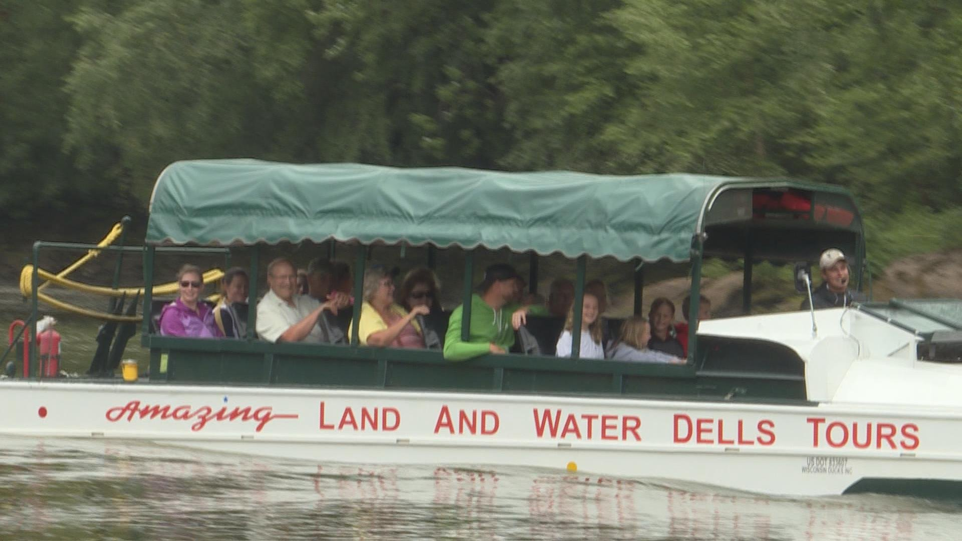 Passengers cruising in a duck boat on the Wisconsin River Friday.