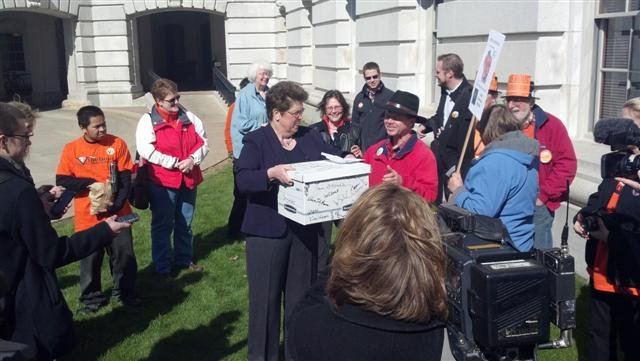 Kathleen Vinehout prepares to turn signatures into the GAB