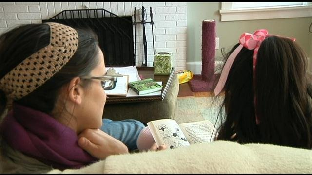 Julia, who has a type of autism spectrum disorder, reads with her therapist