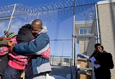 Robert Lee Stinson, 44 (facing camera), walked out of the New Lisbon Correctional Institution in street clothes and hugged his sister and members of the Wisconsin Innocence Project. (AP Photo/Andy Manis)