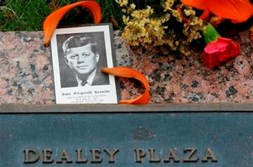 (AP Photo/LM Otero). A photo of JKF and flowers lay on a plaque at Dealey Plaza in Dallas, Thursday, Nov. 21, 2013.