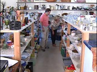 Cheri Nelson shows reporter Joe LaBarbera through her store of 'junk.'