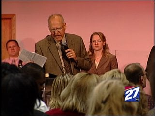 Pastor John Clark and his congregation prayed Sunday for economic recovery at Evangel Life Center in Madison.