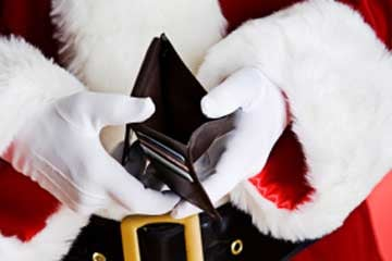 Santa won't be unemployed, but he will find the gift budget is stretched a little thin this year. (©istockphoto.com/Sean Locke)