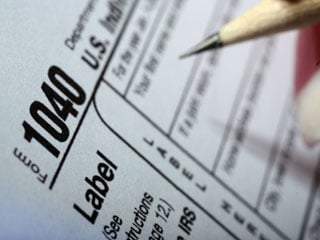 Harvest your investment losses now to cut your tax bill in the spring. (©istockphoto.com)