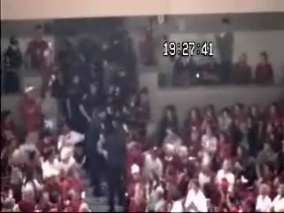 In this frame, UW Police officers had just grabbed Badger fan Margaret Hiebing from the aisle and are carrying her up to the concourse.  Moments later, after a struggle, an officer tasered her.
