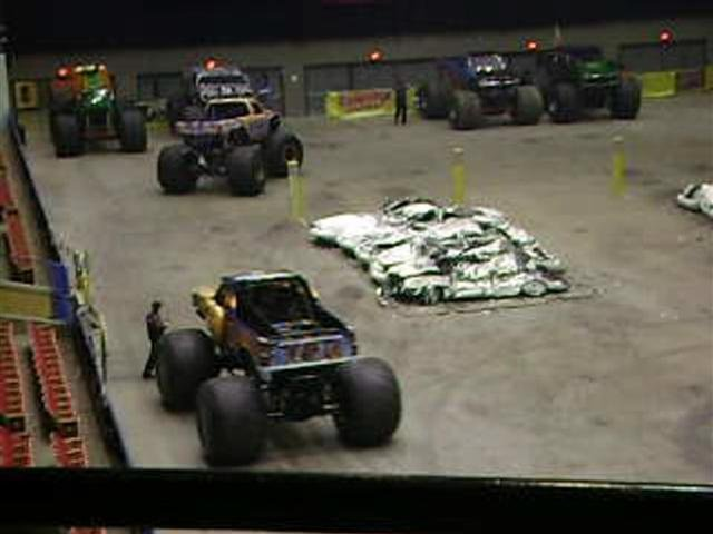 This is a frame of video sent to us by viewer Micah Dehli.  A monster truck is just a second away from running over George Eisenhart, Jr. at Saturday's show, who appeared to be looking the other way.