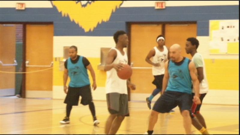 Ymca uses basketball to connect at risk youth officers for Community motors mason city